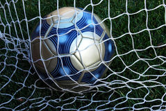 Soccer Ball in Net Stock Images