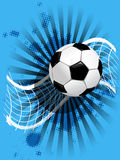 Soccer ball and net on blue Stock Photography