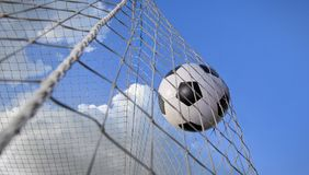 Soccer ball in a net Stock Images