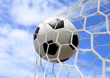 Soccer ball in net. On blue sky royalty free stock photo