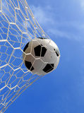 Soccer ball in net. On blue sky Royalty Free Stock Photography