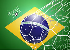Soccer ball in net with brazil flag Stock Photography