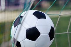 Soccer ball in net, close-up view. Ball net soccer game sport leisure activity Royalty Free Stock Photos