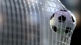 Soccer ball in the net. 3d rendering. Royalty Free Stock Photography