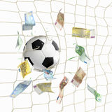 Soccer ball in the net with euro banknotes Royalty Free Stock Images