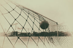 Soccer ball in the net of the goal. Royalty Free Stock Photos