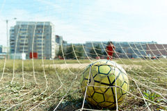 Soccer ball in the net. Photo of a soccer ball in the goal net, during a football tournament on a city street sports tournament in Yoshkar-Ola Royalty Free Stock Photos