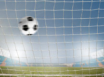 Soccer ball in net Royalty Free Stock Image