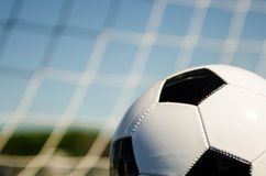 Soccer ball with netting Royalty Free Stock Photos