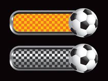 Soccer ball on orange and black checkered tabs Stock Photos