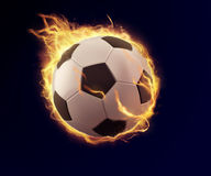 Soccer ball in orange flame Stock Photography