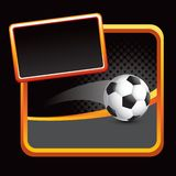 Soccer ball on orange framed stylized banner Stock Image