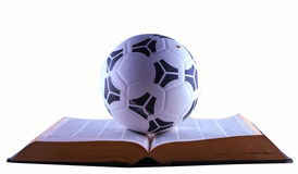 Soccer ball over book Royalty Free Stock Photo