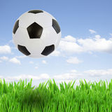 Soccer ball over grass Stock Photo