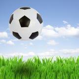 Soccer ball over grass Stock Photo