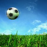 Soccer ball over green field Royalty Free Stock Images