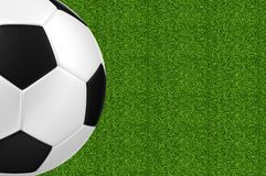 Soccer ball over green grass Stock Images