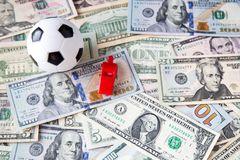Soccer ball over a lot of money. corruption football game. Betting and gambling concept.