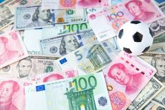Soccer ball over a lot of money. corruption football game. Betting and gambling concept. Wold cup 2018. European cup . UEFA Champions League. premier league royalty free stock photography