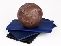 Soccer Ball Paper Weight. On some check books with a white background Royalty Free Stock Image