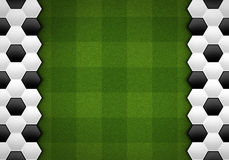 Soccer ball pattern on green pattern Stock Image