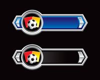 Soccer ball and penalty cards on arrow banners Stock Images
