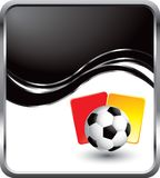 Soccer ball and penalty cards on black wave ad Royalty Free Stock Photos