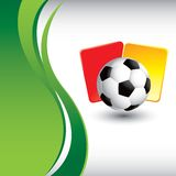 Soccer ball and penalty cards with green wave Stock Image