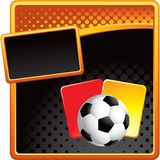 Soccer ball and penalty cards on halftone banner Stock Image