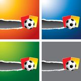 Soccer ball and penalty cards on ripped banners Stock Photography