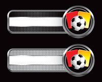 Soccer ball and penalty cards on striped banners. Black and silver checkered striped banners with a soccer ball and red and yellow penalty cards Royalty Free Stock Photos