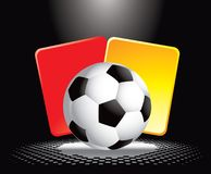 Soccer ball and penalty cards under spotlight Royalty Free Stock Image