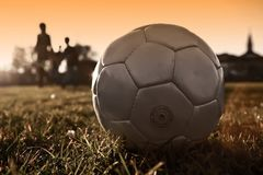 Soccer ball with people silhouette in silver. Version Stock Photo