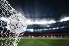 Soccer ball scores a goal on the net. 3D Rendering Royalty Free Stock Photo