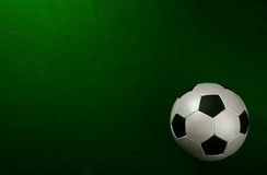 Soccer ball on pitch Royalty Free Stock Photography