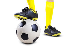 Soccer ball with player feet 1 royalty free stock photography