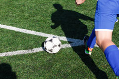 Soccer ball and a player who plays in it. Stock Image