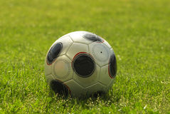Soccer ball in playing field Royalty Free Stock Photos