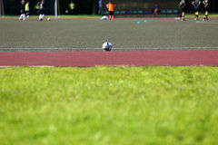 Soccer ball on playing field Royalty Free Stock Photo