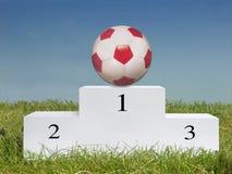 Soccer ball on podium stock image
