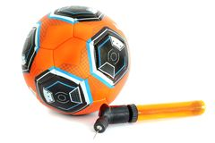 Soccer ball and pump. Sport stock photography