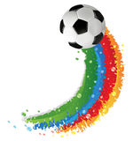 Soccer ball and rainbow trail Royalty Free Stock Photography