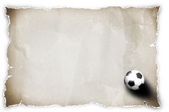 Soccer ball on recycled paper. Royalty Free Stock Image