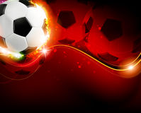 Soccer ball on red  background Stock Photos