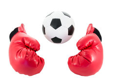Soccer ball with red boxing glove Stock Photo