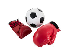 Soccer ball with red boxing glove Stock Photography