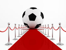 Soccer ball on the red carpet. Rendering Stock Photo