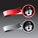 Soccer ball referee on red and silver ribbons Stock Image