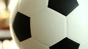 The soccer ball revolves around itself stock video footage