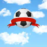 Soccer ball with ribbon flying in the sky Stock Images